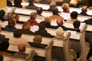 "© 2006 Alex Nikada, ""Praying at church"", via iStockphoto."